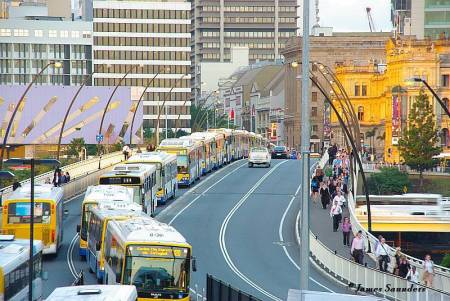 "Another bus ""conga line"" leaving downtown Brisbane, Australia to enter busway."