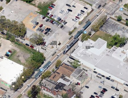 Aerial view of MetroRail on Main St. at Ensemble-HCC station. Photo: Screen capture by L. Henry from Google Maps.