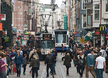 Amsterdam's Leidsestraat shows how gauntlet track allows bidrectional light rail operation in a very narrow alignment, even with very close headways. Also remarkable is how smoothly, efficiently, peacefully, and safely the tram line blends in with, complements, and serves all the pedestrians who walk alongside, behind, and even in front of the trams.