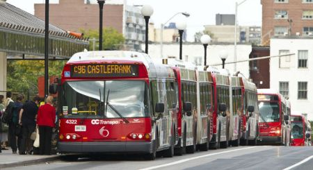 "Ottawa's ""BRT"" Transitway delivers a ""conga line"" of buses onto urban streets. Photo: Errol McGhion."