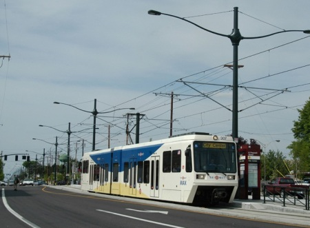 Portland's light rail transit line on 4-lane Interstate Avenue gives an idea of how urban rail could operate in reservation in G-L corridor. (Photo: Peter Ehrlich)