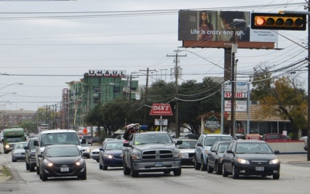 "North Lamar traffic (several blocks north of the Triangle). Guadalupe-Lamar travel corridor carries heaviest traffic flow of any local Central Austin arterial, serves residential concentration ranking among highest density in Texas, serves 31% of all Austin jobs — yet corridor was ""dismembered"" by Project Connect and excluded from ""Central Corridor"" study! Photo: L. Henry."