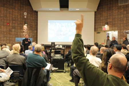 Real community meetings, such as this one focused on transit options in Toronto, allow free and open discussion and facilitate questions and comments from the attendees. In contrast, Project Connect's events have squelched community discussion and sought to manage and muzzle discussion. Photo: Torontoist.