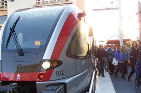 Commuting passengers deboard a MetroRail train. During SXSW, passengers have jammed onto trains, setting new ridership records. Photo: L. Henry.