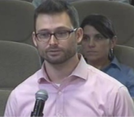 Marcus Denton announces AURA's opposition to Project Connect plan at CCAG meeting. Screenshot from City of Austin video.