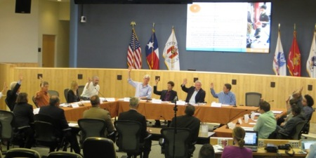Majority of CCAG votes to endorse Project Connect urban rail plan. AURA leader Julie Montgomery, at table at left in photo, voted No. Photo: L. Henry. (Click to enlarge.)