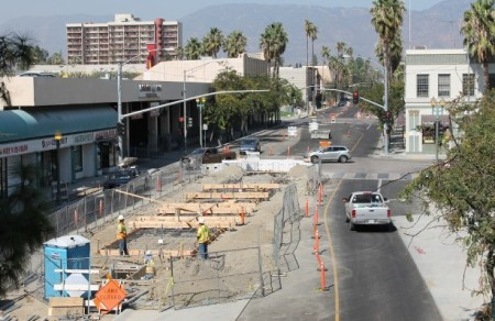 "Construction for dedicated bus lanes, rarely shown by ""BRT"" promoters, is very similar to that for LRT, as this example from San Bernardino demonstrates. Yet effective capacity, ridership attraction, cost-effectiveness, TOD, and other benefits typically fall short of what LRT typically achieves. Photo: Omnitrans.org."