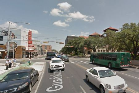 Busy section of Austin's Drag, Guadalupe St. at W. 24th St. Official city planning by CTR has proposed curbside transit lanes, with buses running on outside lanes as seen in this photo. (Screenshot from Google Streetview.)
