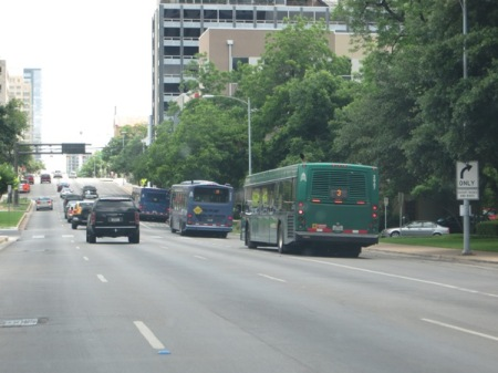 Buses use curbside reserved lanes on one-way Lavaca St. downtown. Curbside lanes on the Drag would be similar, but on two-way street. Photo: L. Henry.