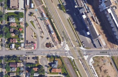 In this Google Earth view, Hiawatha Ave., with the LRT line paralleling it on its western edge, runs diagonally north-south through the center of the photo. The 38th St. LRT station can also be seen, while E. 38th St. crosses both LRT line and Hiawatha Ave. east-west, in the bottom third of the graphic. Note that Hiawatha and the LRT line intersect E. 38th St. at about a 60-degree angle, somewhat similarly to Airport Blvd and N. Lamar and the MetroRail Red Line in Austin. Photo: ARN, from Google Earth.