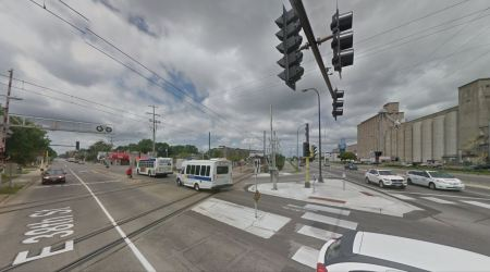 From a surface view, this shows the intersection protected with crossing gates. Photo: ARN, from Google Street View.