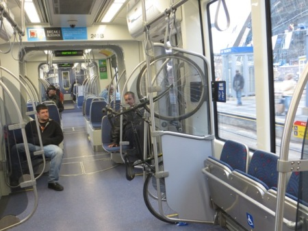Bikes can be hung on special racks inside the LRT cars. Photo: L. Henry.