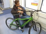 17_ARN_min-lrt-int-pax-holding-bike-20151118-1957-z_lh