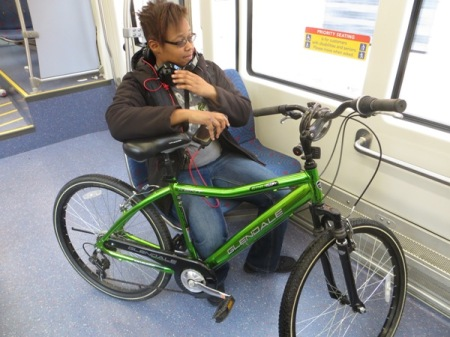 In some cases, smaller bikes are simply held by the passenger. Photo: L. Henry.