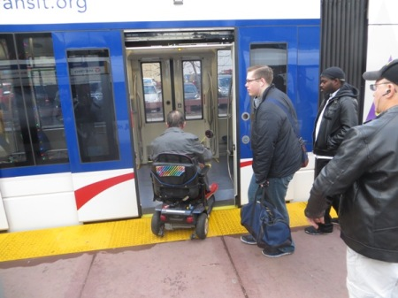 Passenger in wheelchair boards train at downtown station. Photo: L. Henry.