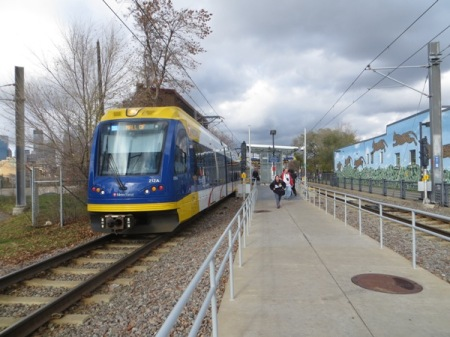 Blue Line train at Cedar-Riverside station, closer in to the CBD, where the former railroad ROW is quite narrow. This is similar to the narrow railroad ROW of Austin's MetroRail (Red Line), which ARN and other groups have advocated to be converted to LRT (from its current status as a diesel-propulsion light railway). LRT's electric propulsion enables faster, smoother train operation that is less costly, cleaner, and friendlier to urban livability.