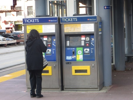 Passenger purchases ticket from TVM at downtown station. Photo: L. Henry.