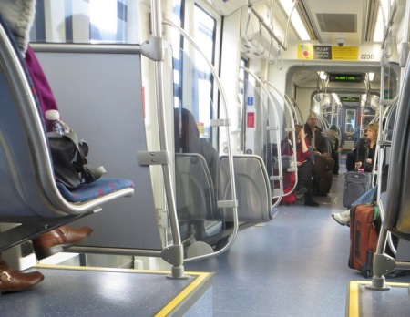 Lots of visible baggage on Blue Line train gives an indication that LRT service to Minneapolis's airport is well-used by air passengers. Photo: L. Henry.